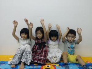 kids hands raised